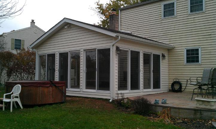Drumm design remodel sunrooms sunrooms lansdale pa for Sliding glass doors sunroom