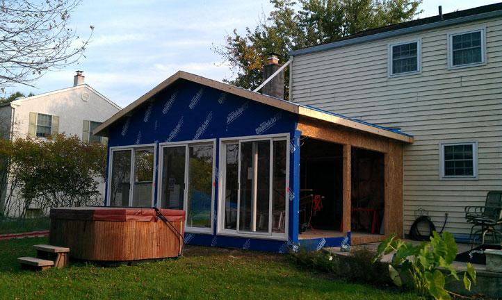 The walls are up vapor barrier going around the sunroom for Sliding glass doors sunroom