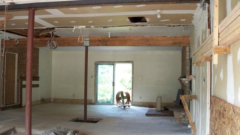 Drumm Design Remodel Installs New Ceiling Support Beams