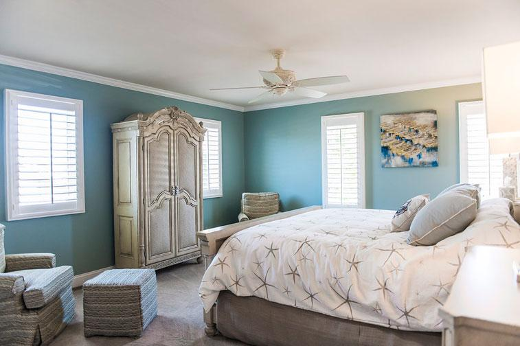 a view of this bright and airy master bedroom from the hallway and office
